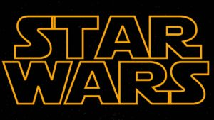 Star Wars logo - gold on black, stars in background