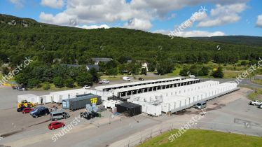 "Mandatory Credit: Photo by Andrew Smith/Shutterstock (10337560a) James Bond film set at the Ardverikie Estate near Aviemore James Bond film set, Aviemore, Scotland, UK - 15 Jul 2019 Filming on the new James Bond movie has begun at Ardverikie Estate near Aviemore in the Scottish Highlands. A complex chase sequence is being filmed which will involve vehicles being driven at speed along forest tracks and through a river. One large section of river is being prepared for a stunt involving a dam. Another action sequence codenamed ""cavalry charge"" is also being filmed at the estate, along with a helicopter sequence that promises to surprise audiences. Hundreds of crew members are based in a village of small accommodation pods at nearby Aviemore."