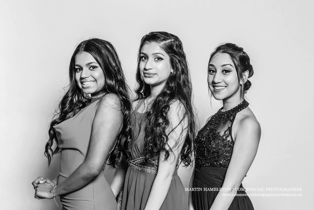 group of three girls in prom photos