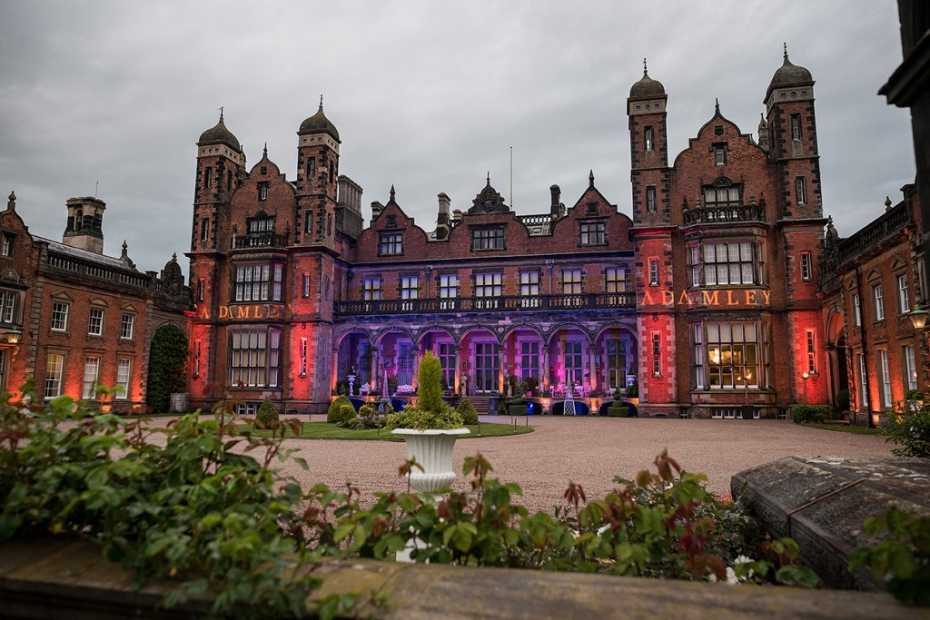 capesthorne hall with lights on the frontage