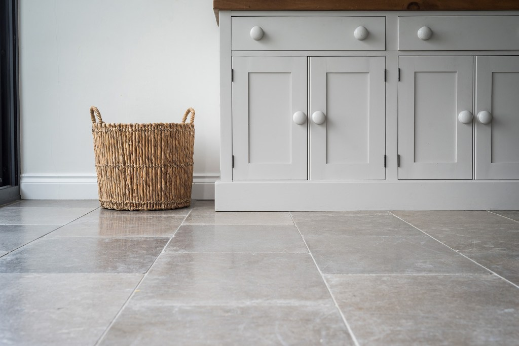 advertising photography image of stone kitchen floor and dresser