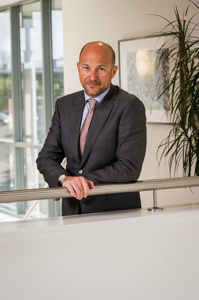 portrait photography of businessman in office building