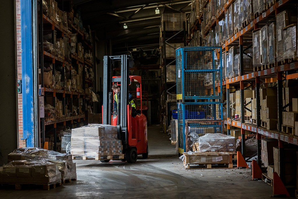 fork lift truck in operation in warehouse