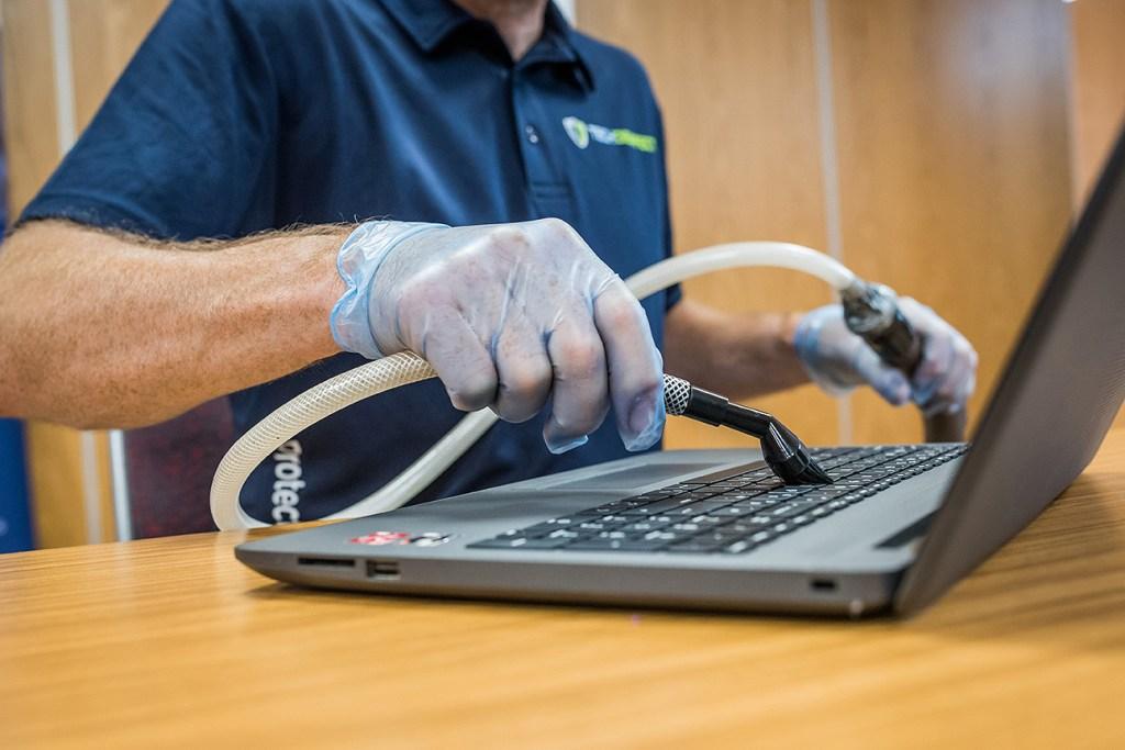 vacuum hoovering laptop keyboard