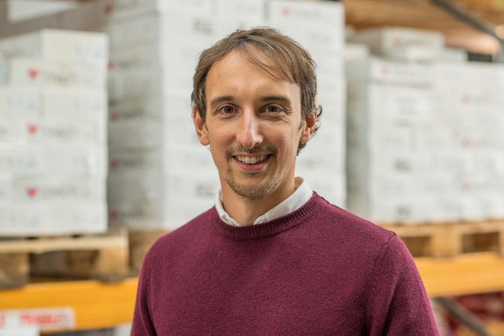 commercial portrait of man in warehouse