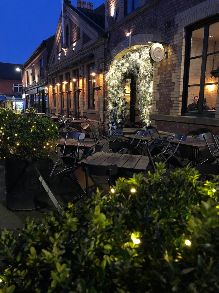 photo of Con Club restaurant in Altrincham at night showing the different light sources