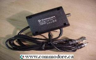 COMMODORE AUTO SWTICH BOX: This is a rare Commodore auto switch box. It connects the Commodore computer to a coax cable on the back of a modern TV set. It will automatically switch from the cable signal to the computer signal, when the computer is turned on. This product is very unique and very rare.