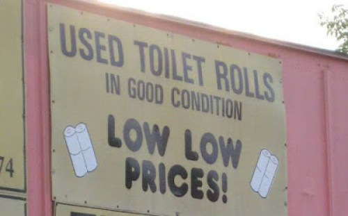 Sign Of The Day Used Toilet Rolls