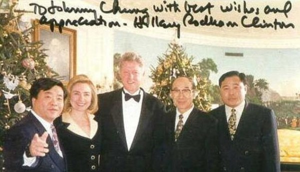 An intimate photo of Johnny Chung and the Clintons, signed by Hillary.