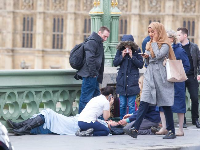 Picture Of The Day: Muslim Woman Walking Past The Injured