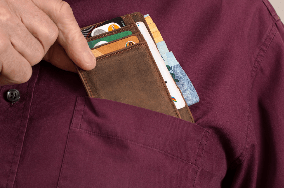 man putting credit card in pocket