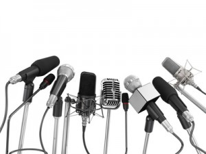 Various microphones aligned at press conference isolated over a