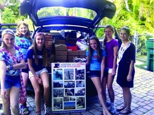 Pictured with the boxes they packed are (l-r) Lisa Amore, Victoria Harris, Julia Richardson, Meredith Flinn, Claire Landon, and Sydney Howard.