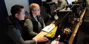 Dell volunteer working with learner