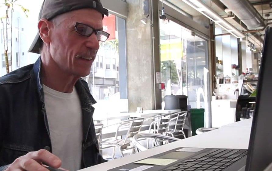 Ira using Skype on his new laptop.