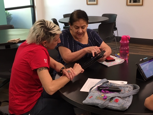 Adobe volunteer Jill working with Stella