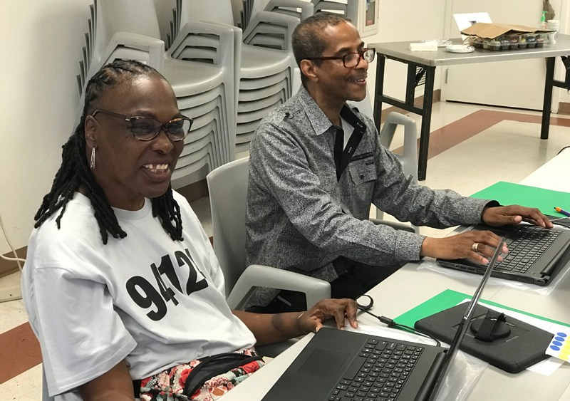 Two students participating in a laptop class in the Bayview of San Francisco