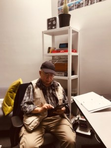 Yun Kwong Wong using tablet