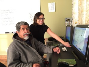 Photo of volunteer Anna and learner Fernando