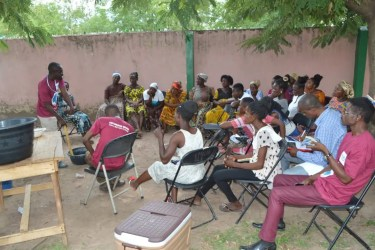 Image of women listening to women empowerment talk Ghana