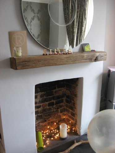 A mantlepiece made from an old railway sleeper
