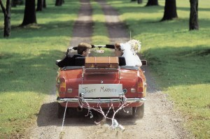 Bride and Groom, Just Married, Driving Away in Car