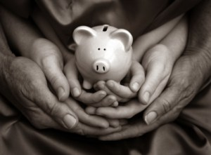 family hands piggy bank