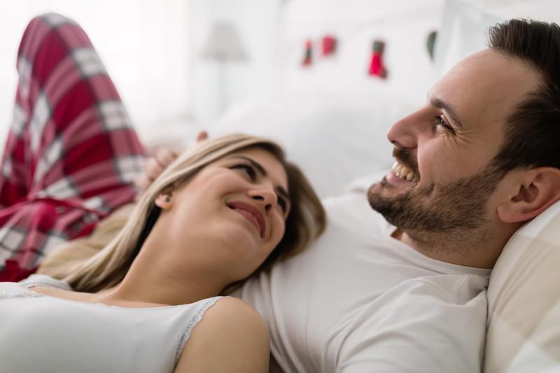 Happy couple romantic sex bedroom