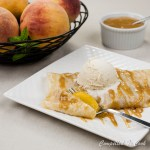 Spiced Peach Crepes nestle spiced peaches in a tender crepe, topping with caramel and vanilla ice cream.