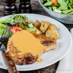Pork Chops with Hard Cider Sauce are spiced rubbed juicy pork chops adorned with a hard cider pan sauce.