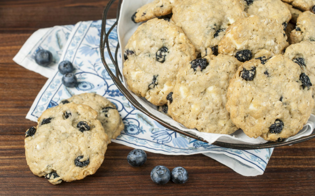 Blueberry White Chocolate Oatmeal Cookies are loaded with plump dried blueberries, oatmeal, white chocolate and a hint of cinnamon for a great chewy cookie.