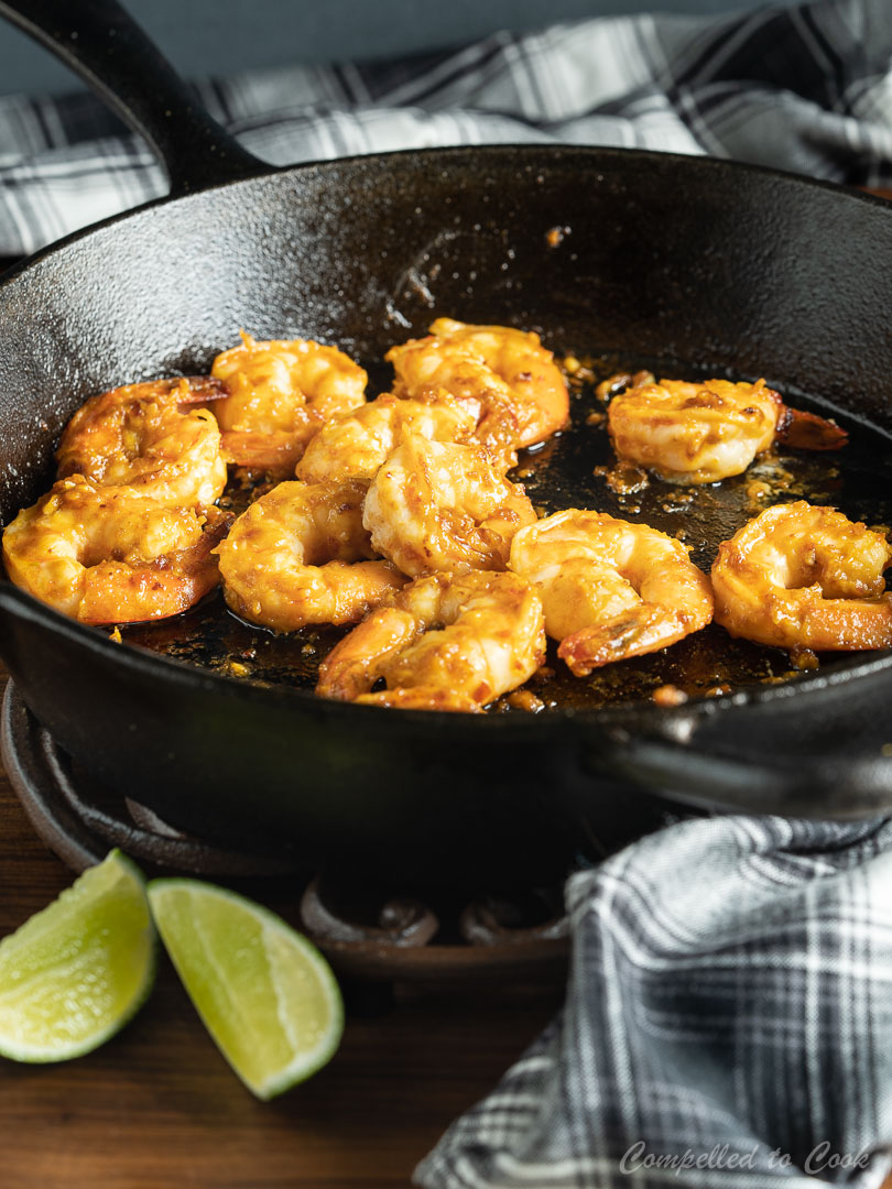 Panfried Spicy Miso Shrimp in a cast iron skillet.