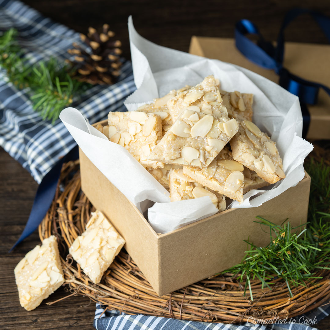 A box of crisp and buttery Jan Hagel Cookies wrapped with a navy blue ribbon.