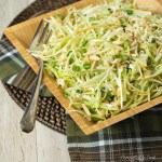 Japanese Cabbage Salad served in a square wooden bowl and garnished with sliced green onions.
