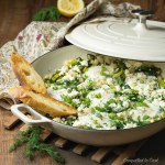 Spinach and Feta Shakshuka ready to serve from a shallow braiser.