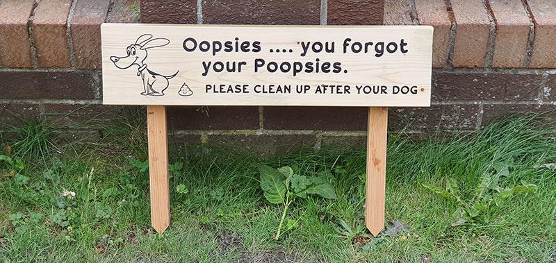 Dog poop sign closeup