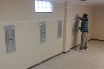 crew installing wall anchors