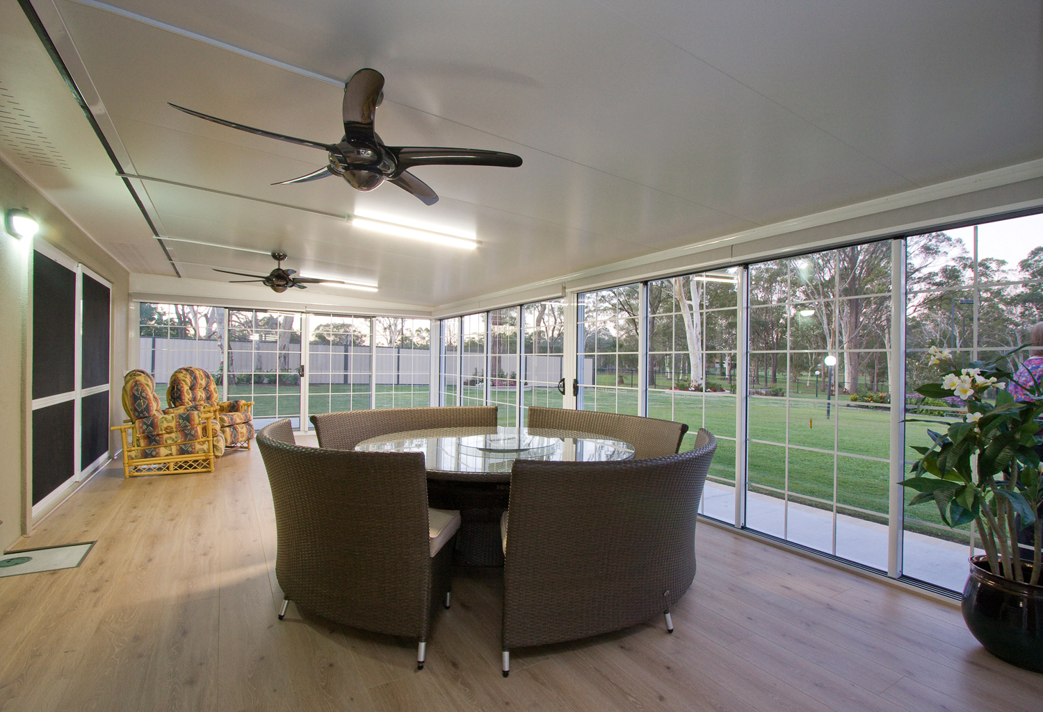 outdoors in with an enclosed patio
