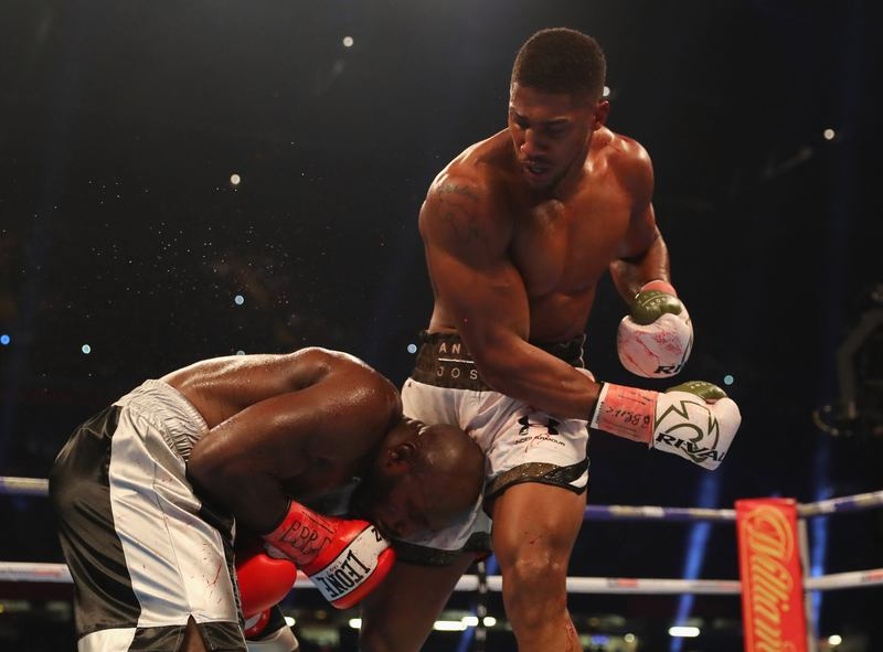 Joshua Retains World Titles After TKO Of Takam