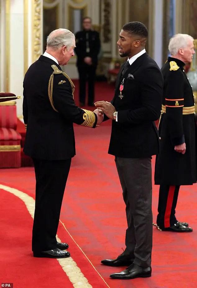 Joshua Receives Royal OBE Award From Prince Charles