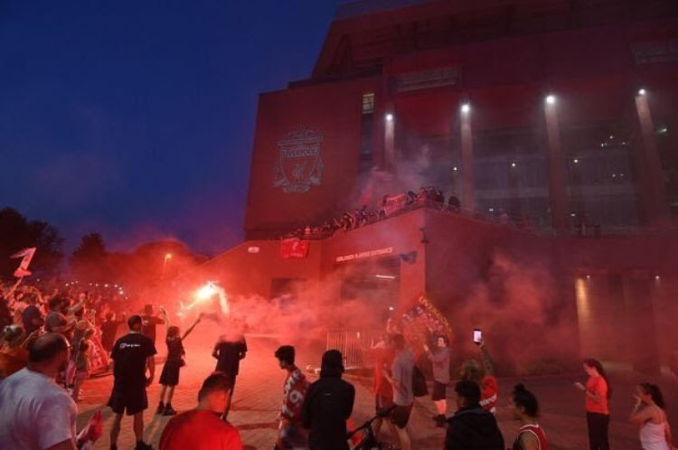 Liverpool Fans Defy Police Warnings, Gather At Anfield To Celebrate On PL Trophy Night