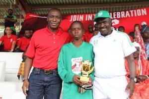 Managing Director, Coca-Cola Limited, Adeola Adetunji; Best Goal-keeper, James Ogene Tega; and President, Nigerian School Sports Federation, Mallam Ibrahim Mohammad.