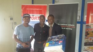 L - R Demola Aloko (Programmer) Jide Oladokun (Accounts Executive) with prize winner Aifuwa Emmanuel
