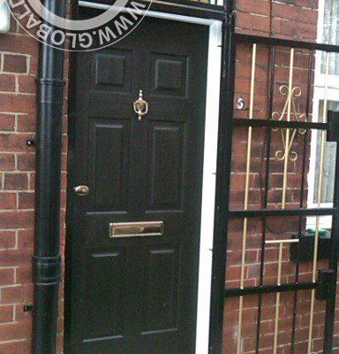 black-6-panel-global-composite-door-gold-hardware
