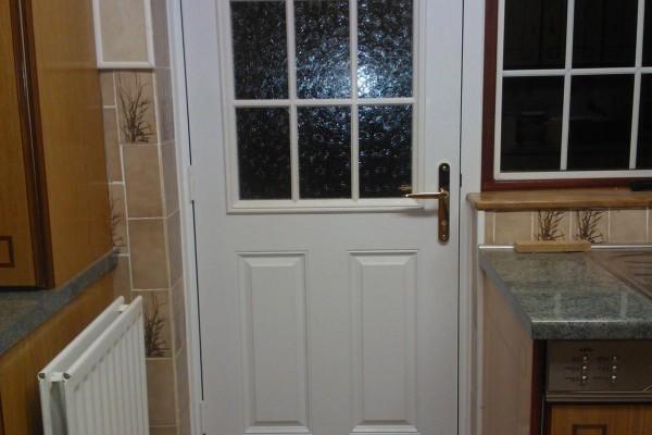 white-2-panel-sunburst-global-composite-door 2