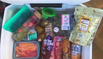 Overhead shot of a beach cooler filled with food