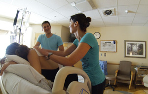 A Doula giving a massage.
