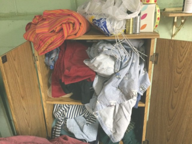 Cloth on appropriate color coded shelf.