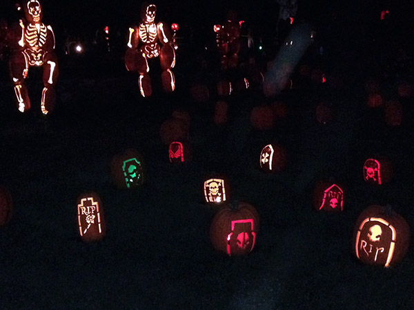 Skeletons and gravestones carved from pumpkins
