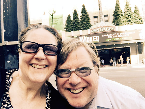 Laurie and Mark in front of the Wicked Marquee at the Pantages